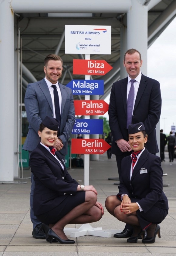 Celebrating the launch of flights to five new destinations are Luke Hayhoe (left) and Andrew Cowan with British Airways' cabin crew Paulina Stasiak (left) and Danielle Bellini - Picture by BA.