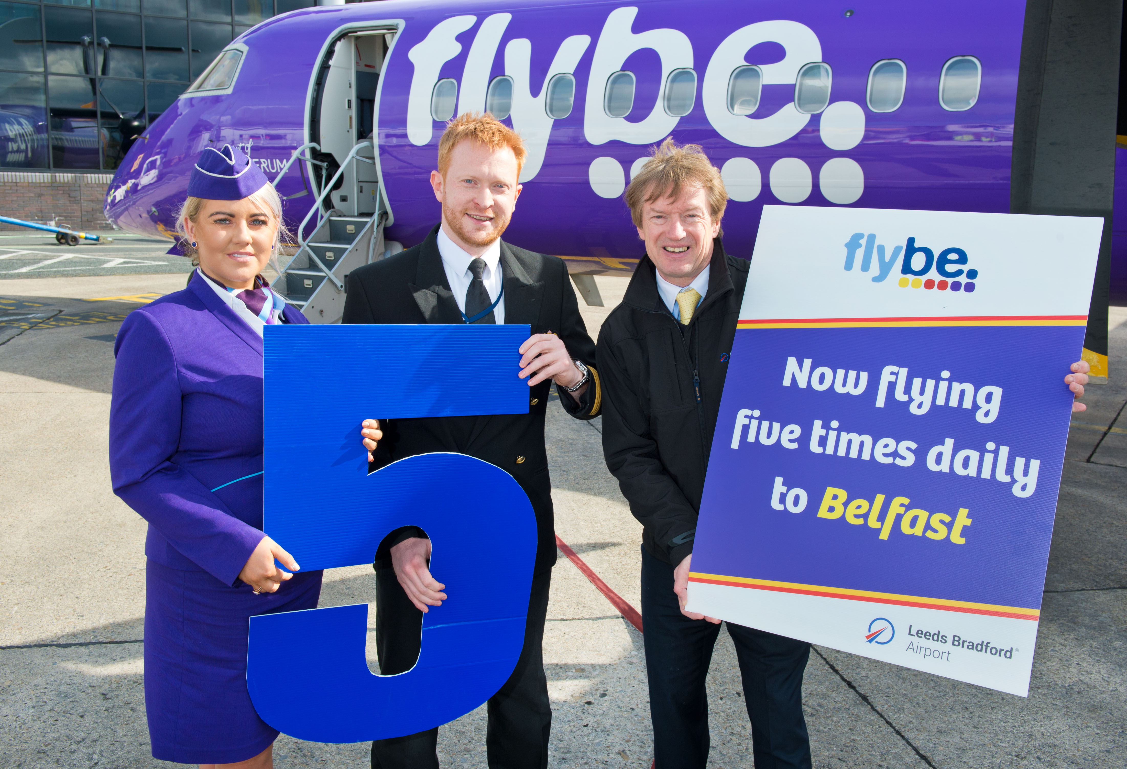 Image caption: Tony Hallwood, right, with Flybe's crew to celebrate the fifth rotation from Leeds Bradford Airport – which starts today. Photograph by Richard Walker/ www.imagenorth.net