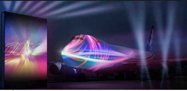 L to R  Large projection screen   -  B747 with colorful image projection Photo © Boeing Company