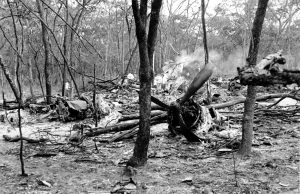 This is a general view of men searching the site of the plane wreckage near Ndola, Zambia on Sept. 19, 1961. Passenger U.N. Secretary General Dag Hammarskjold was en route to a meeting with Katanga's President Moise Tshombe to negotiate the Congo crisis at Ndola when his plane crashed in a forest near the city on Sept. 18. (AP Photo)