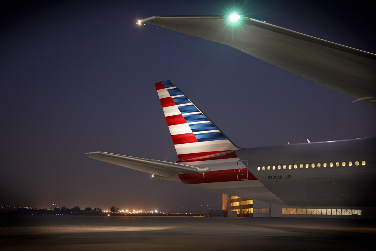 American Airline 777 tail outside at night